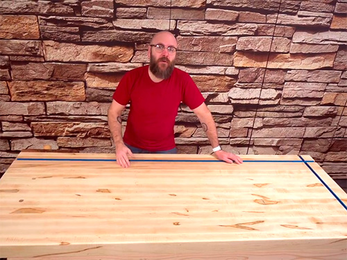David Picciuto demonstrating a workbench with installed t-tracks