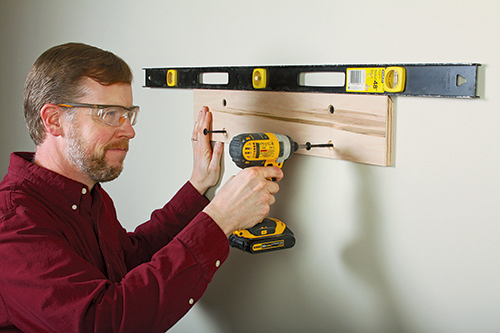 Attaching wall cleat for holding clamp storage rack