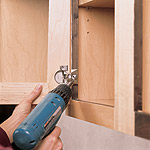 Mounting European cup hinge to cabinet casework
