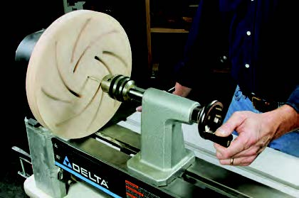 Longworth bowl chuck attached to the lathe for drilling