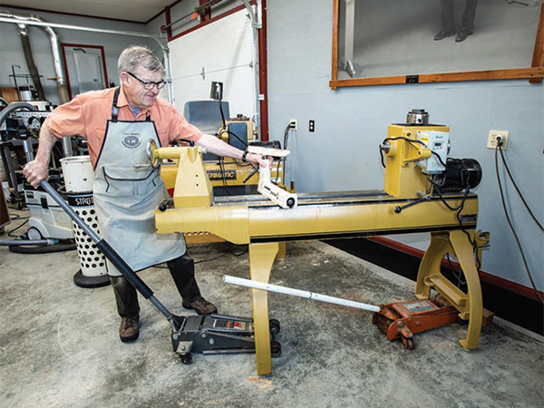 Using a jack to lift and move a full-size lathe