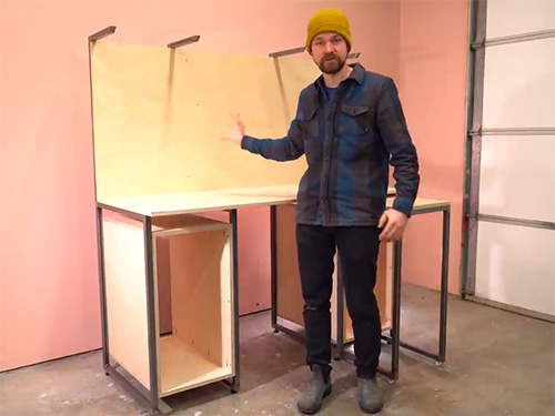Michael Alm demonstrating his multipurpose workbench desk