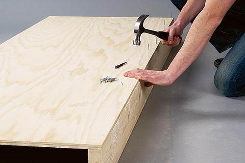 Attaching rails to convertible coffee table bed base