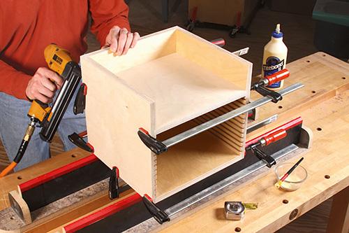 Using a nail gun and glue to assemble table saw blade organizer