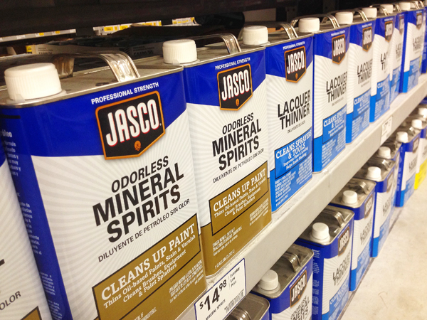 Store shelf stocked with mineral spirits and paint thinners