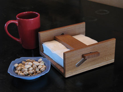 White oak napkin holder displayed on a table