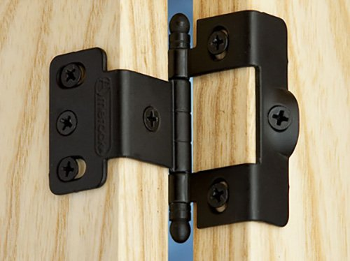Close up of a no-mortise hinge installed in a cabinet