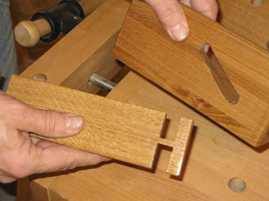 Notches cut in napkin holder rail for sliding mechanism