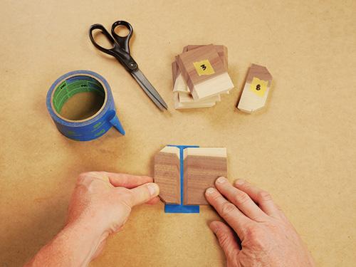 painters tape used as hinge on piece of wood