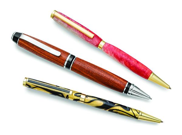 three turned wood pens