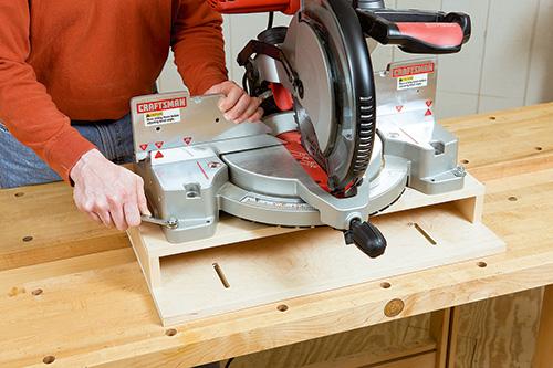 Mounting miter saw on raised, movable platform