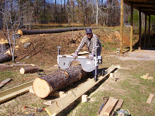 Custom built track and bed for lumber smith saw mill