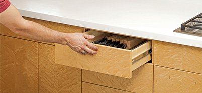 Drawer with no handle or pull that must be pushed to be opened