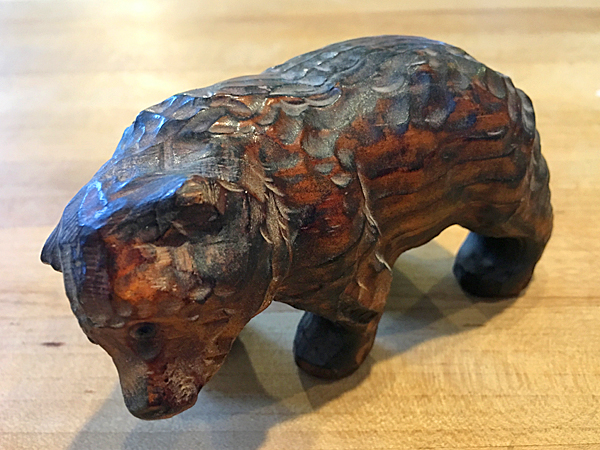 Small redwood carving of a bear with mineral oil finish