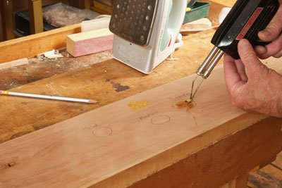 Using an electric iron and shellac to repair dent in wood