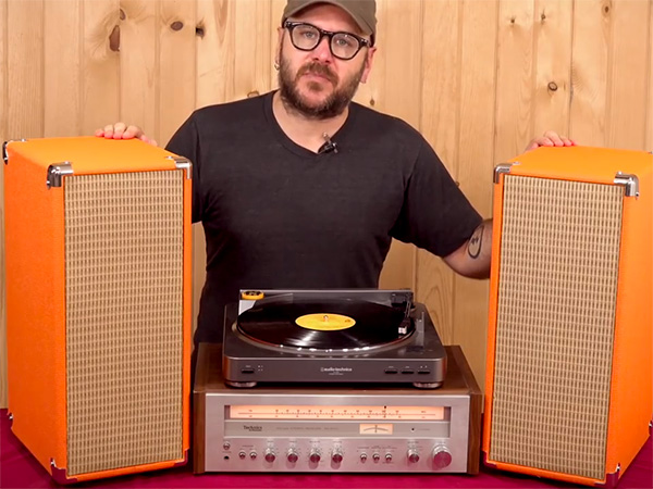 David Picciuto showing plywood speakers designed like vintage guitar amps