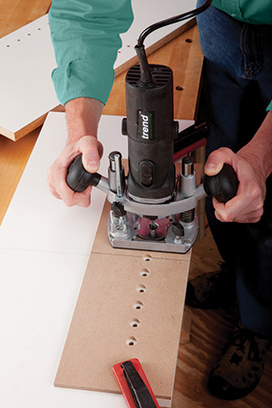 drilling round holes with router