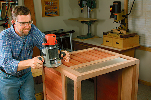 Rounding outer corders of storage box with a router and roundover bit