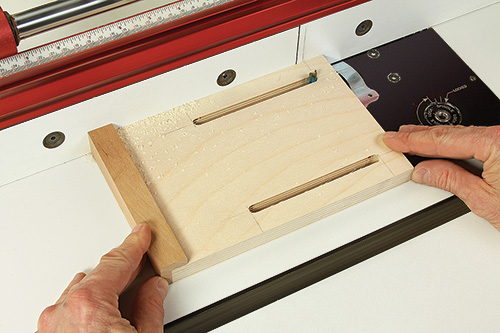 Cutting slots in mortising jig stop for adjusting mortises