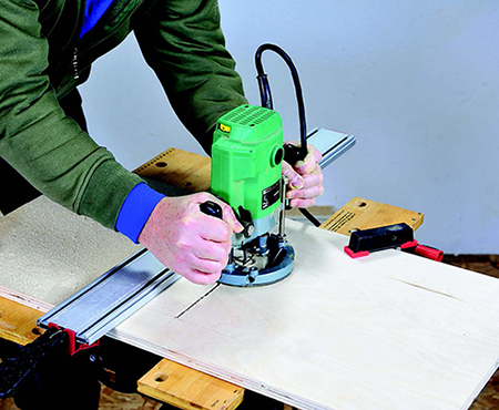 Using router to cut slot in tool storage cabinet shelf