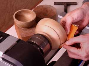 Using a lathe to aid in bowl sanding