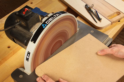 Smoothing cutting board corners with a disc sander