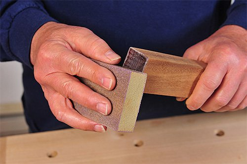 Smoothing epoxy end grain seal with a sanding block