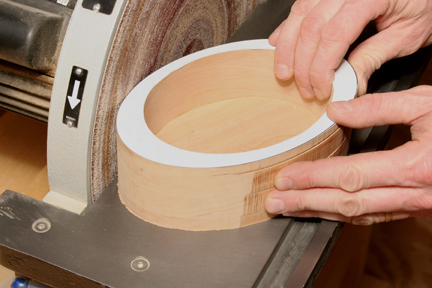 Using a disc sander to smooth the outside of keepsake box