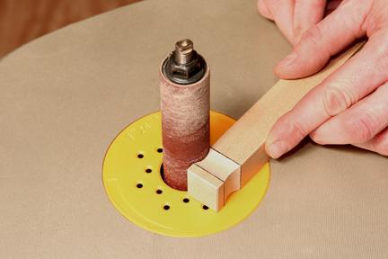 Sanding knob for keepsake box in piece of square scrap