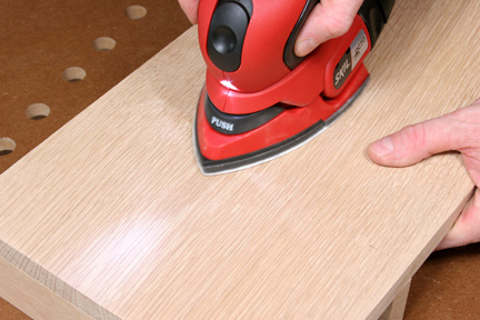 Sanding installed wood plugs flush with wood panel