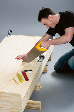 Sawing convertible coffee table and bed in half