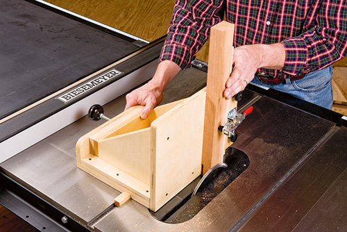 Adjustable tenoning jig in use on a table saw
