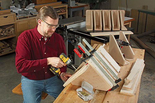 Attaching braces to clamp storage rack panels