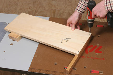 Attaching crosscut jig fence to base with screws