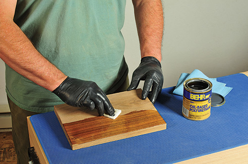 Scrubbing a polyurethane finish with a white Scotchbrite pad