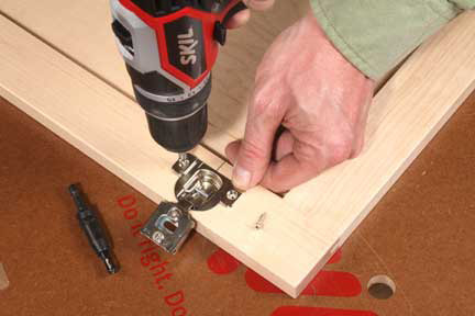 Using a self-centering bit to attach european hinge to cabinet door frame