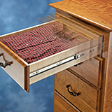 View of drawer slide with motion blur indicating that it is closing by itself