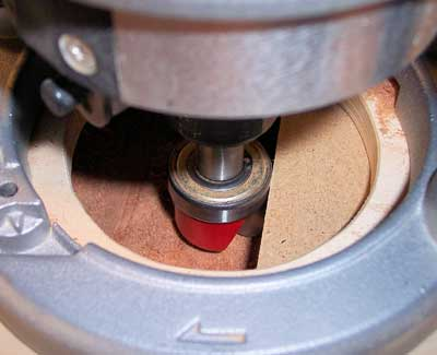 Side view of a dish carving router bit preparing to make a recess cut