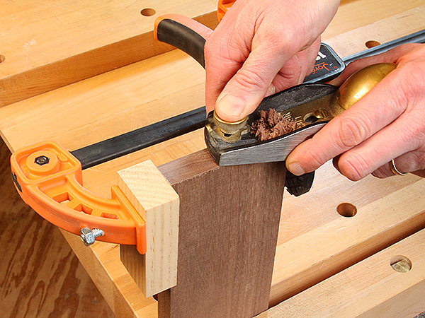 Cutting the end of a piece of lumber with a low angle block plane