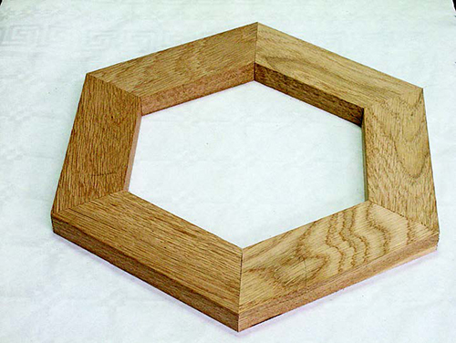 Six sided frame with angles cut using a miter cutting sled