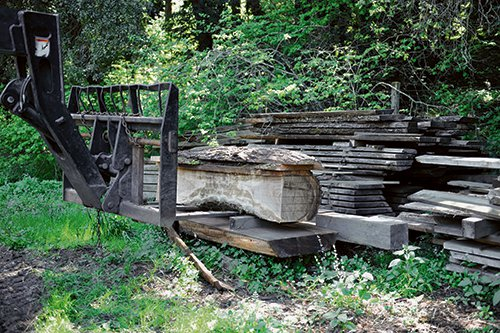 Stacking boards cut from logs to dry on a pallet