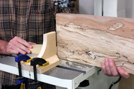 Catching book-matched panel as cut finishes