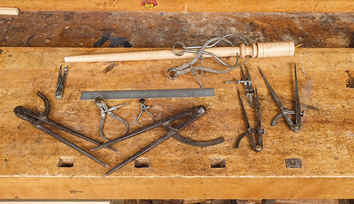 Collection of calipers and dividers for turning measurments
