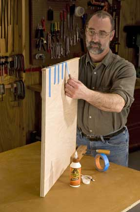 Taping down edge banding for glue-up