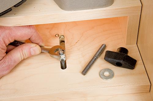 Tightening movable hanger bolts inside miter saw platform