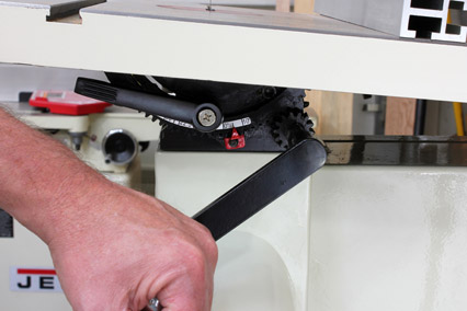 Tilting band saw table to make tapering cuts