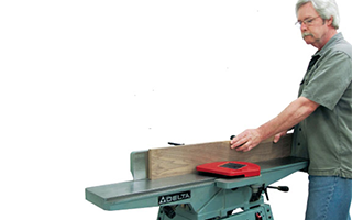AJ Hamler using a jointer