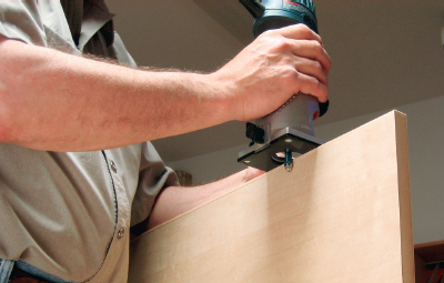 Cutting off edging overhang using a router