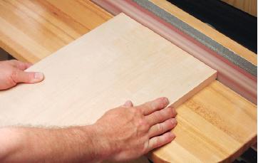 Sanding edging ends flush with an edge sander
