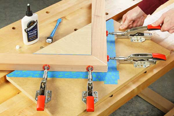 Clamping together a miter joint with toggle clamps